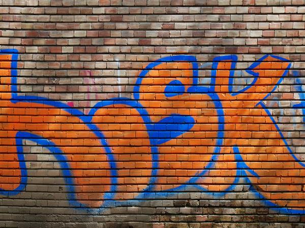 Orange bricks wall with graffiti texture