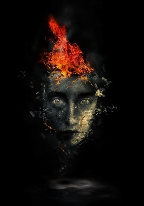 Surreal human face with flame hair and disintegration effect in Photoshop