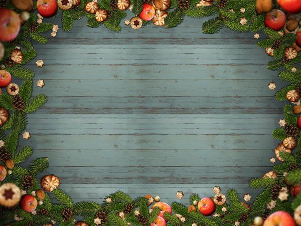 free christmas frame with fir cones apple cookies on wood background
