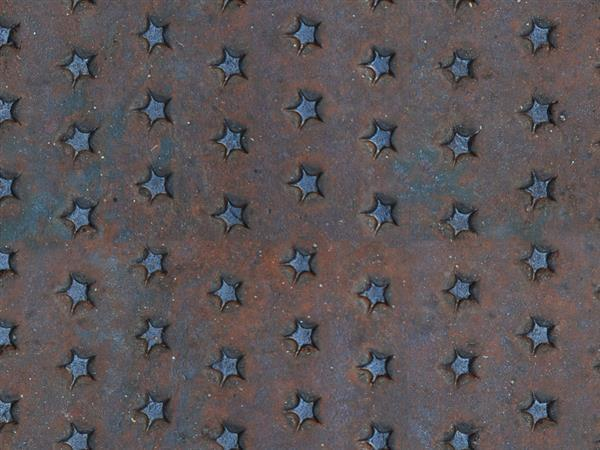 Free seamless rusty metal texture with embossed star pattern